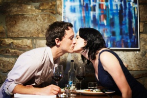 Couple kissing in restaurant